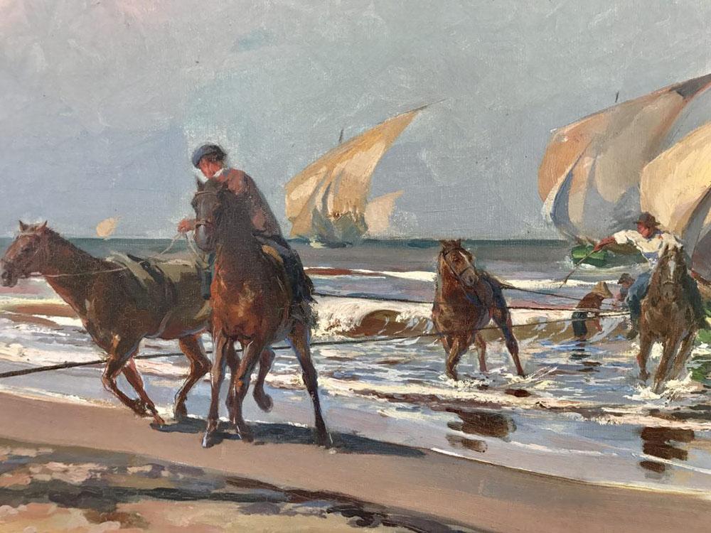 Caballos sacando las barcas del mar